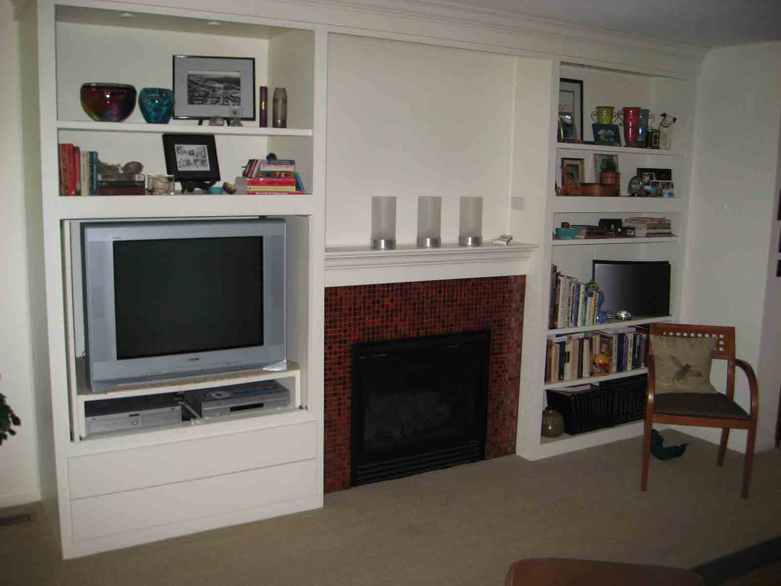 cabinet built ins around fireplace submited images